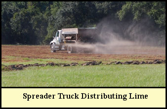 Spreader truck distributing lime at Shady Pond Tree Farm for pH adjustment prior to planting.