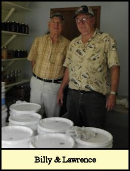 Billy & Lawrence in honey processing building.